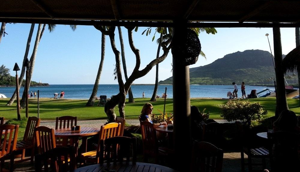 Drink with an ocean view at Beach House Restaurant in Kauai - Hawaiianly.com
