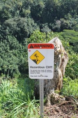 Wailua Falls hazardous cliff sign - Hawaiianly
